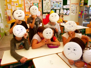 Students raise their paper plate masks to identify their feelings . & paper plates | ELT inspired