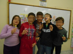 "The winners of the "" Life Skills "" priorities pyramid "" competition   holding their...lollipop awards!"